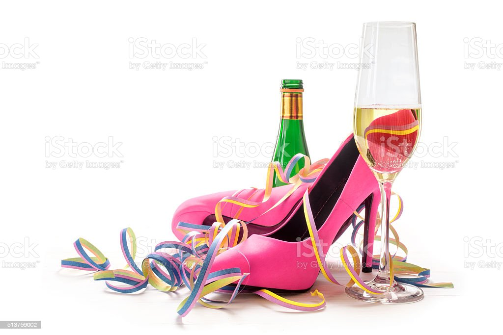 women's day, ladies pink high heels shoes, champagne and streame stock photo
