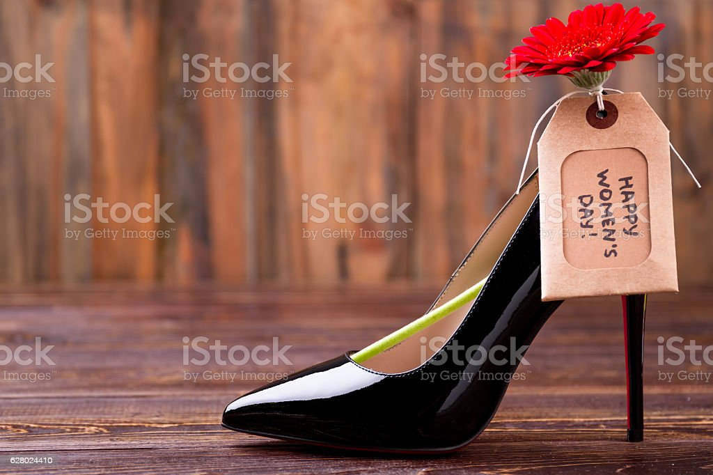 Women`s day tag and shoe. stock photo