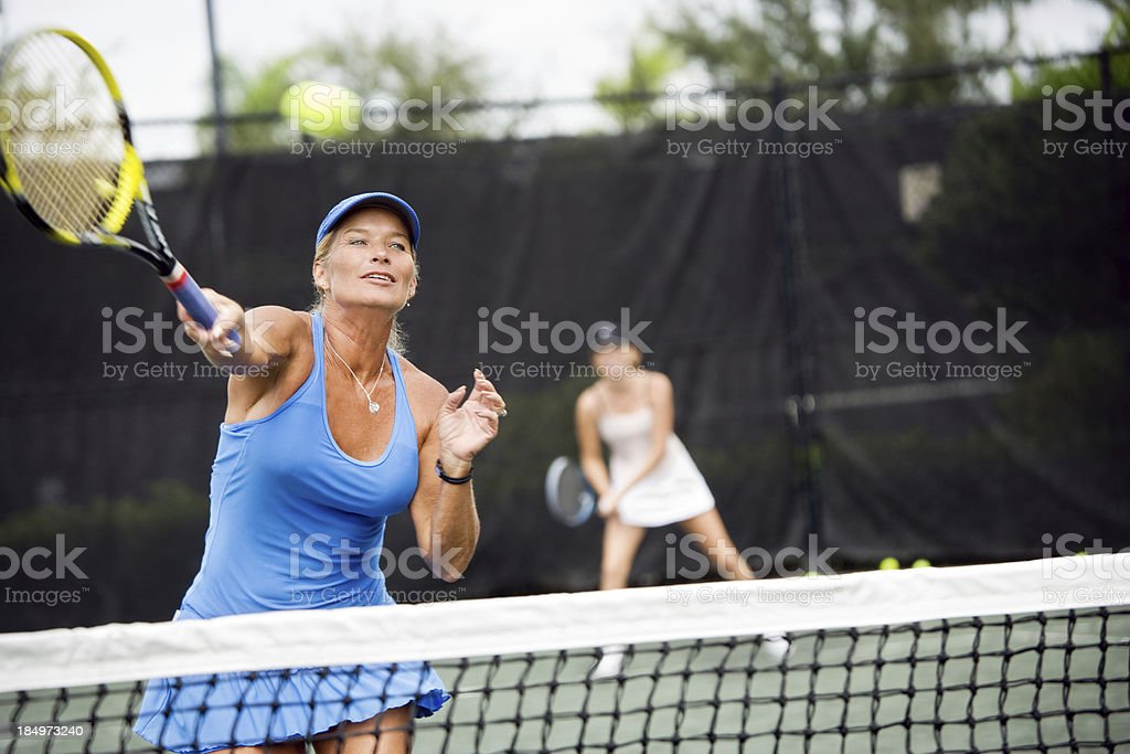 Womens doubles match tennis volley stock photo