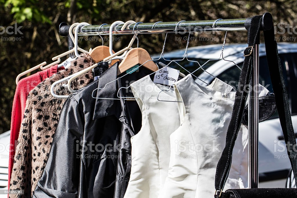 women's dresses and jackets for reselling at flea market stock photo