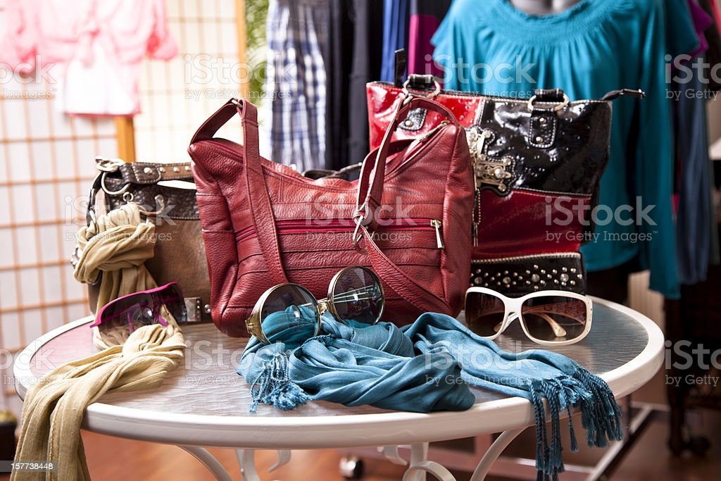 Women's fashion accessories in retail store window display. Purses, clothes. stock photo