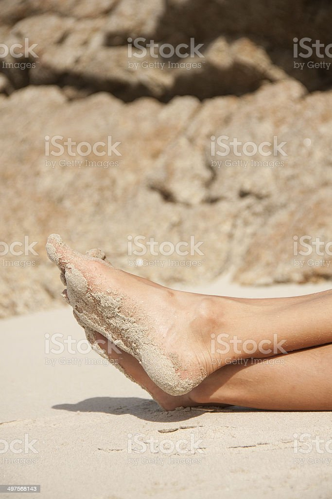 women's feet in the sand royalty-free stock photo