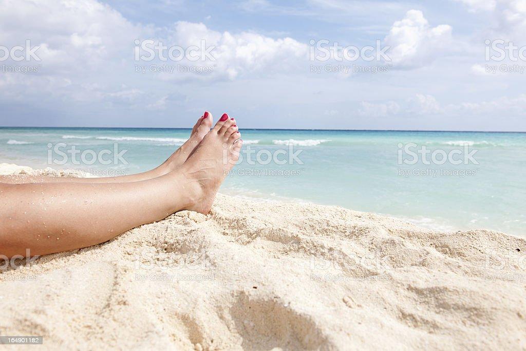 Women's Feet on Beach stock photo