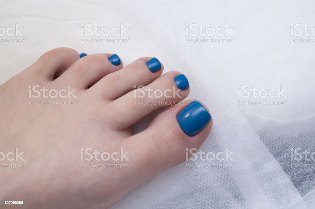 Women\'s foot and clean pedicure, natural nails. Gel polish applied.