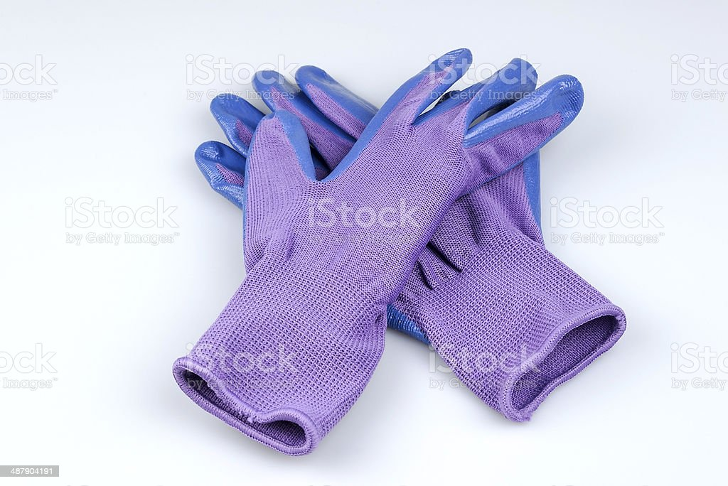 Women's gardening gloves on a white background stock photo