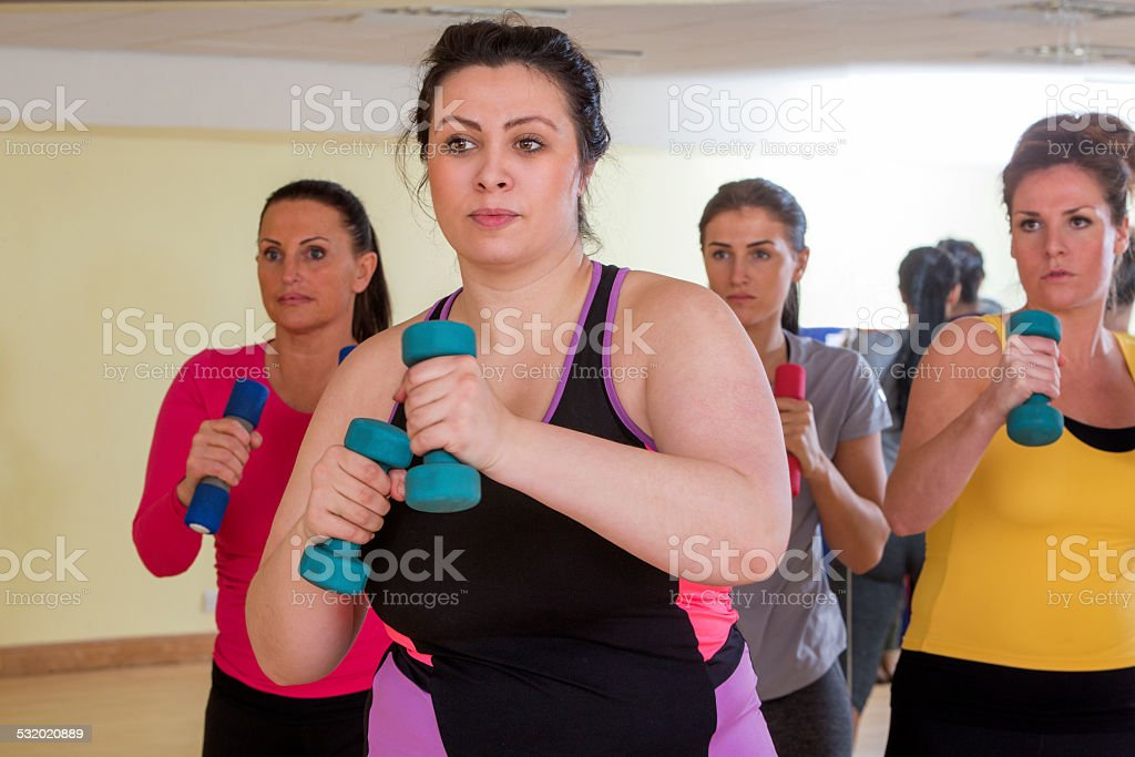 Womens Gym Fitness Class Using Weights stock photo