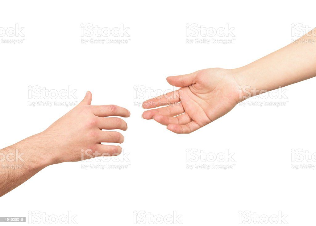 Women's hand goes to the man's hand on white background stock photo