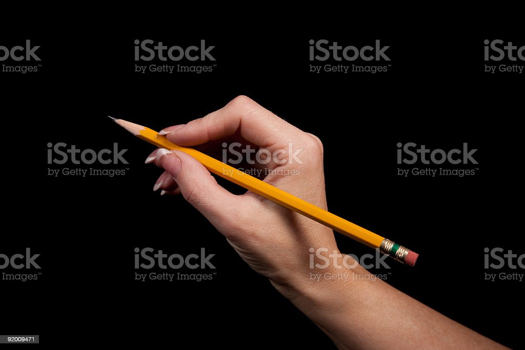 Women's hand holding pencil royalty-free stock photo