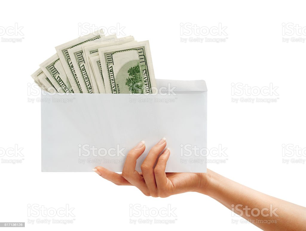 Womens Hand passes the envelope with dollars stock photo
