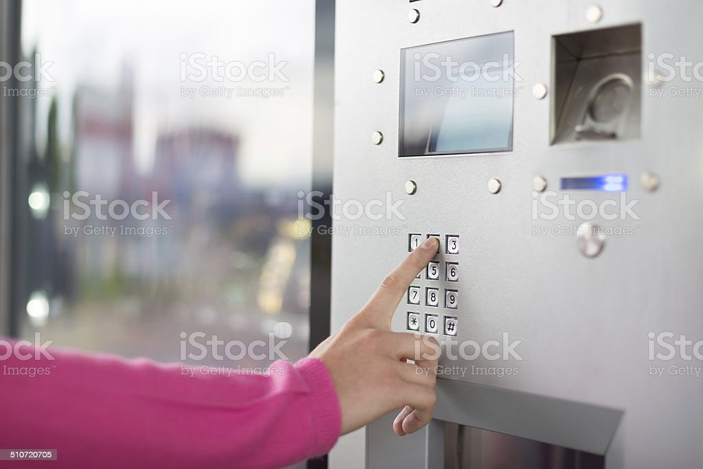 Women's hand using a dial pad. stock photo