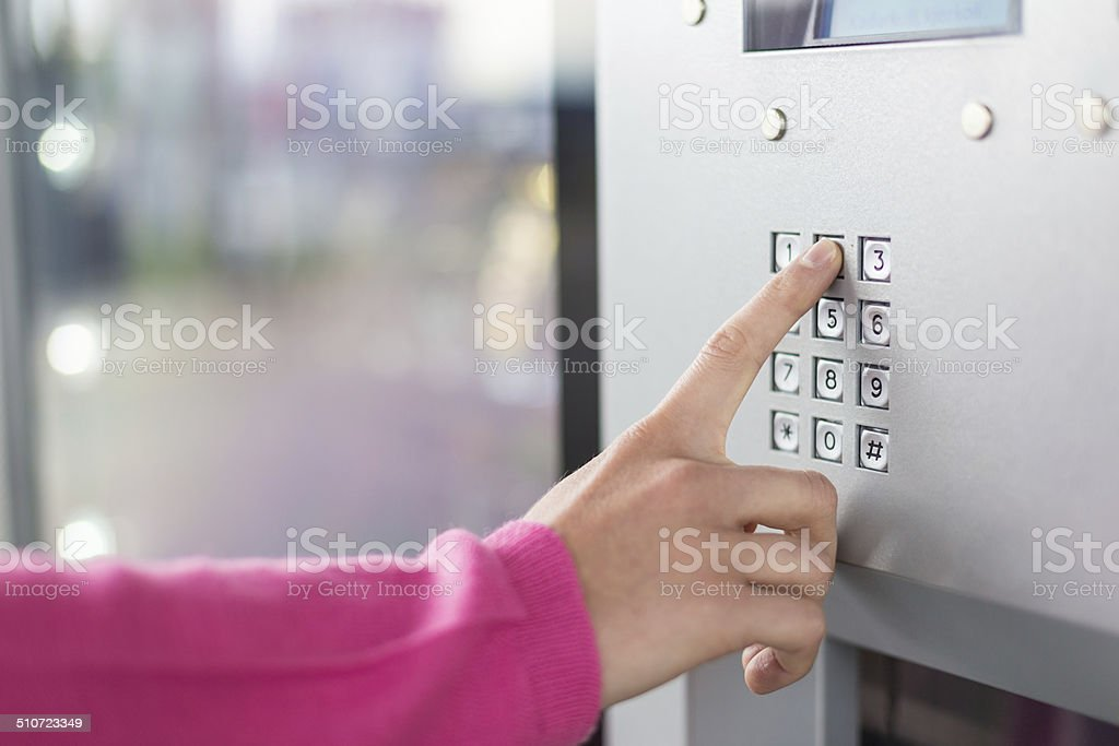Women's hand using a dial pad stock photo