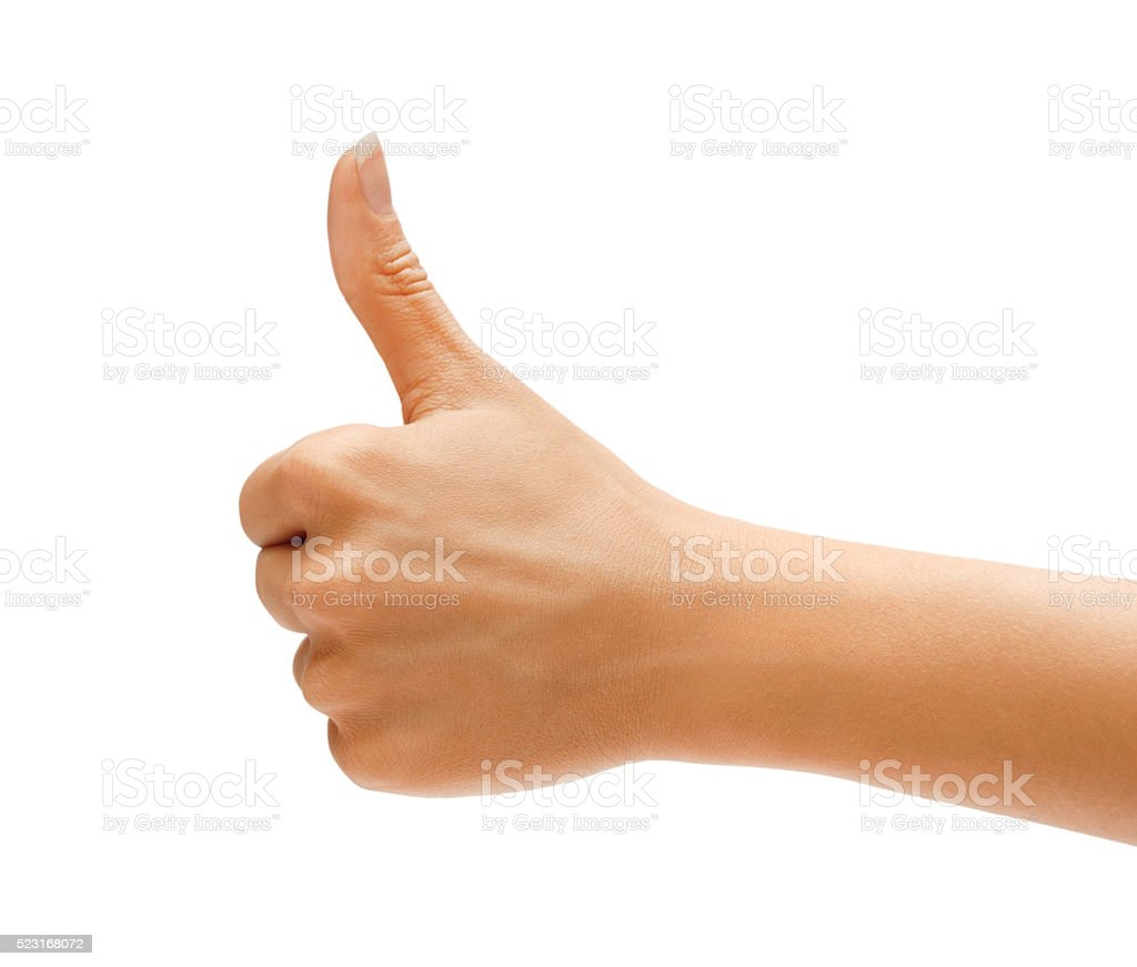 Women's hand with thumb up stock photo