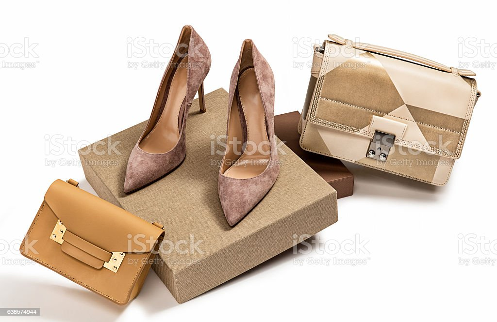 Women's handbags and high heel shoes stock photo