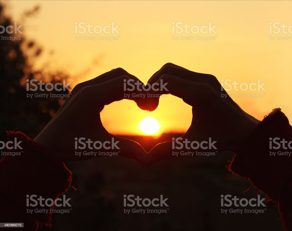 Women's hands are crossed in the form of the heart stock photo
