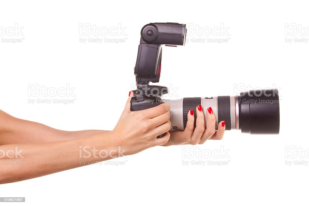 Women's hands holding the camera. stock photo