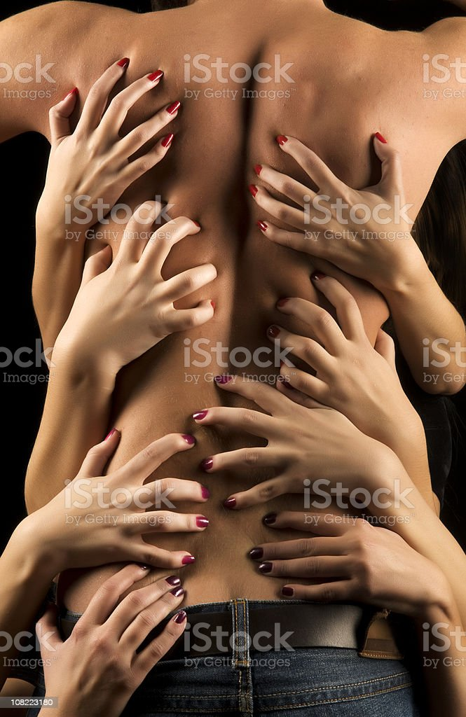 Women's Hands Suggestively Holding Shirtless Man's Back royalty-free stock photo