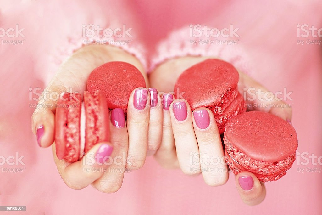 Women's hands with a beautiful pink manicure stock photo