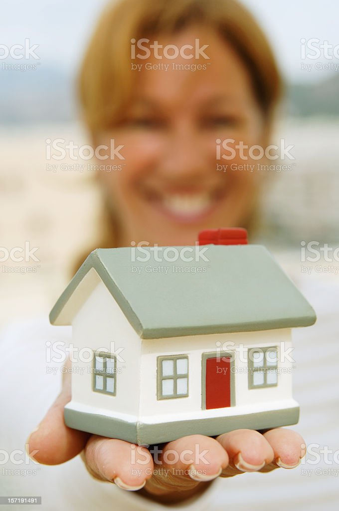 Women's hands with a little house stock photo