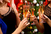 Women's hands with crystal glasses of champagne