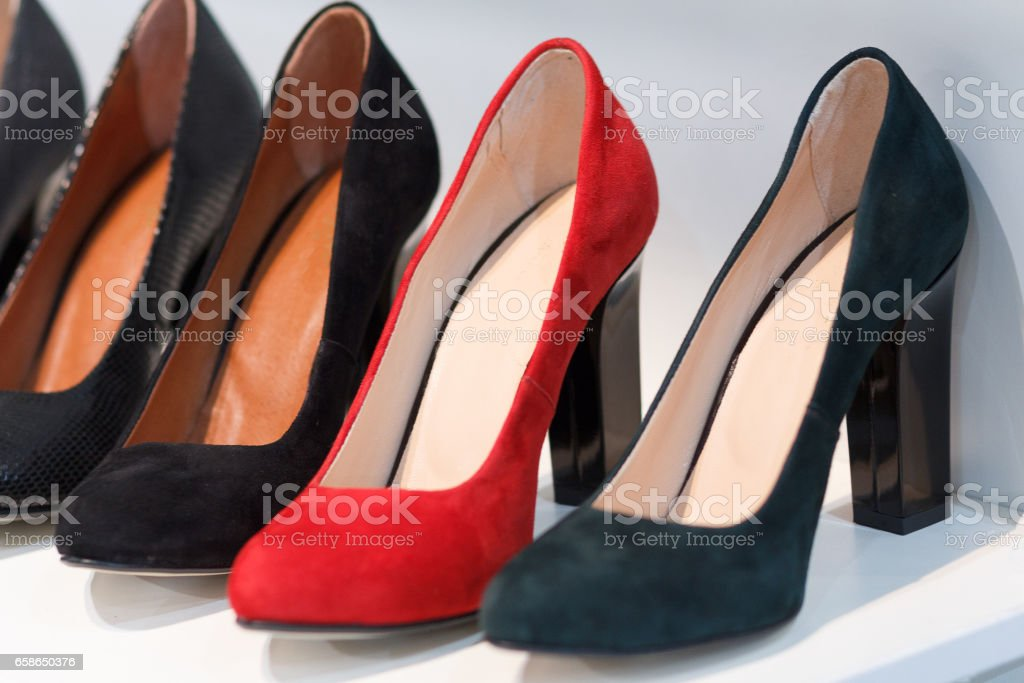 Women's high-heeled shoes on the counter closeup stock photo