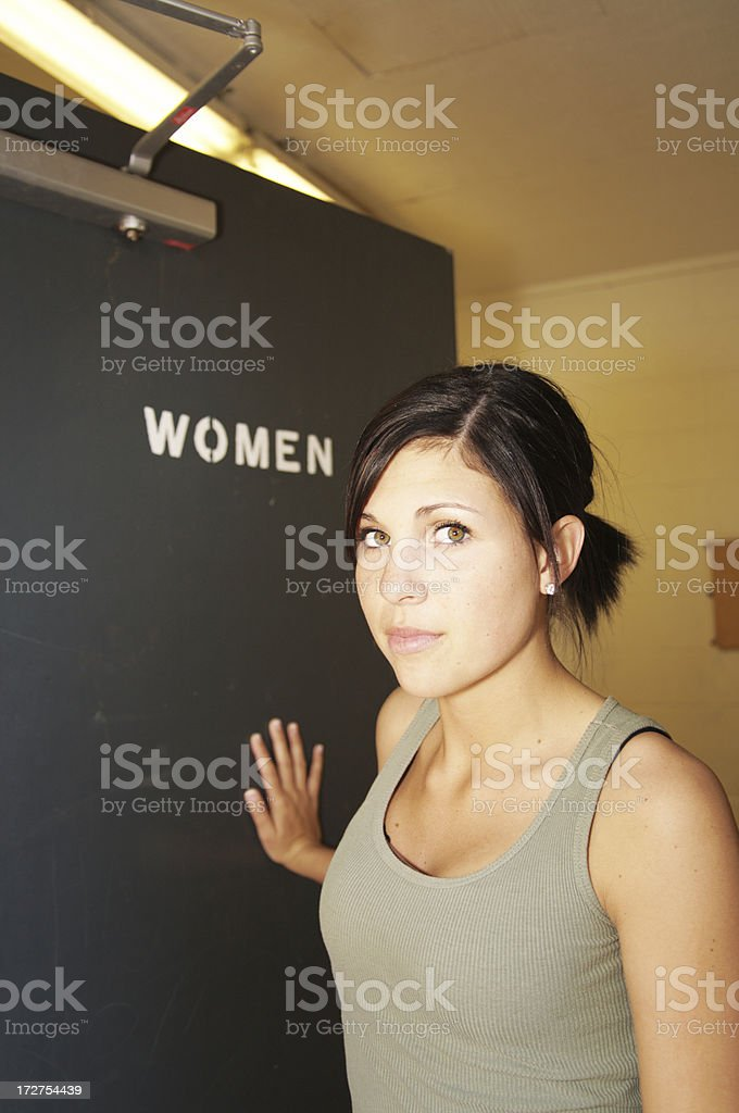 Womens Issues Public Restroom Series Looking at Camera royalty-free stock photo