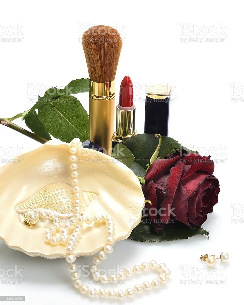Women's jewelry, cosmetics and a rose in still life royalty-free stock photo