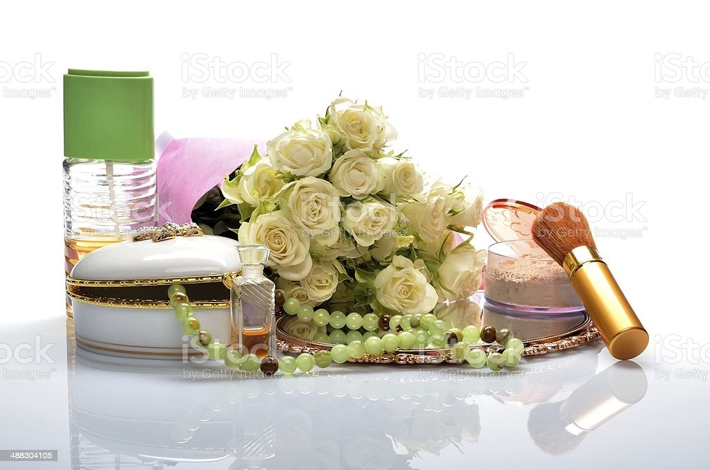 Women's jewelry, perfumes, cosmetics and a bouquet of flowers royalty-free stock photo