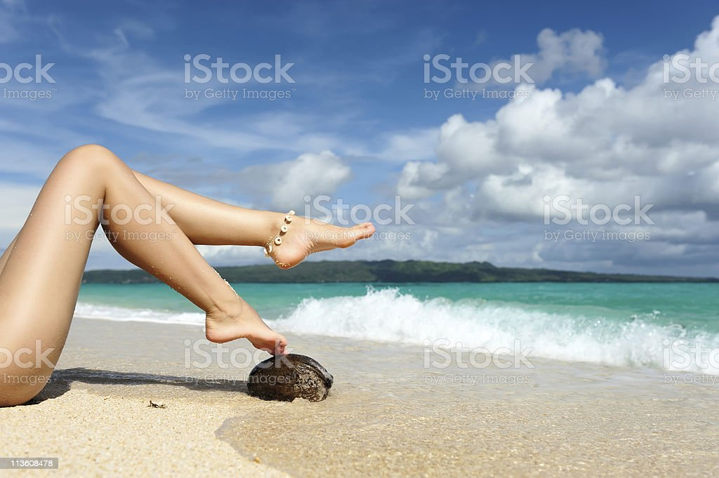 Women's legs on a beach royalty-free stock photo