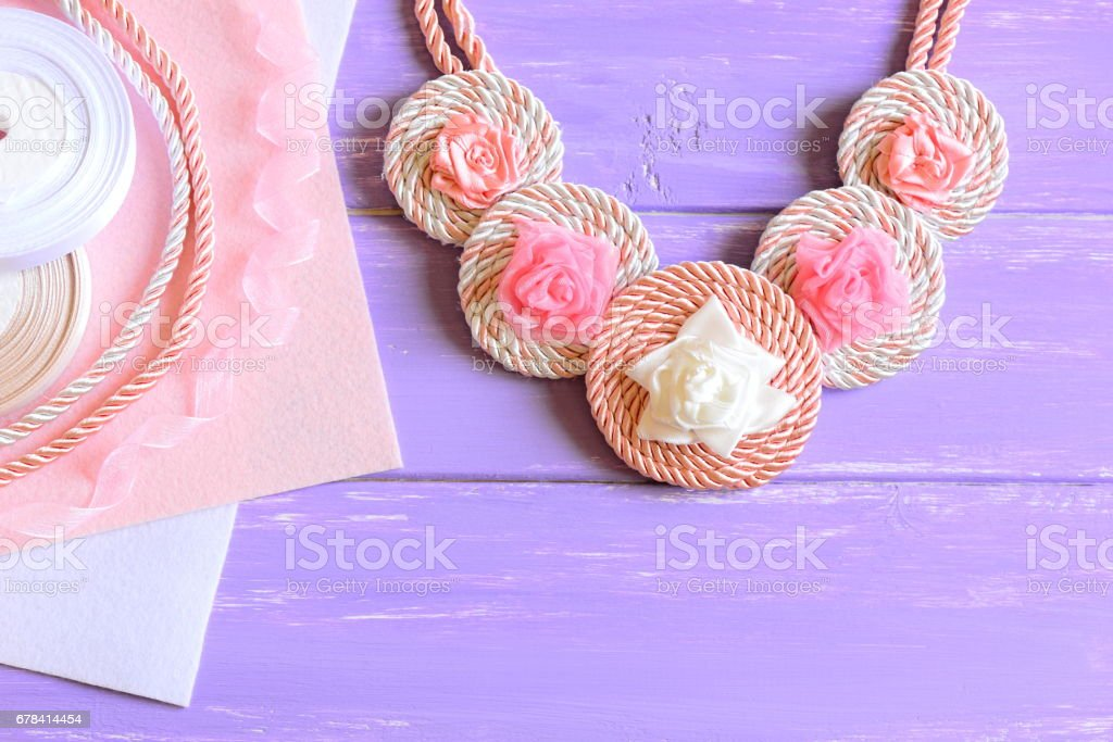 Women's necklace made of ribbons, cords and felt stock photo