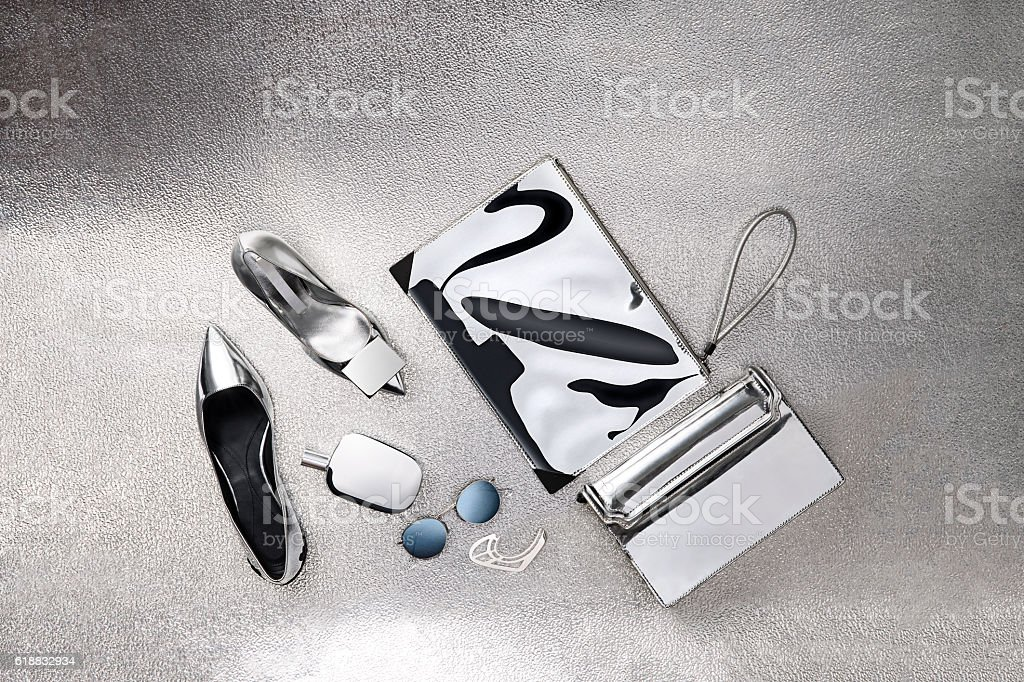 women\'s personal accessories isolated on silver background