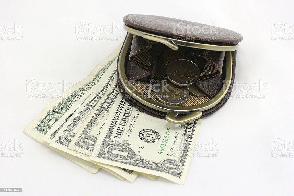 Women's purse opened with a coins in it royalty-free stock photo
