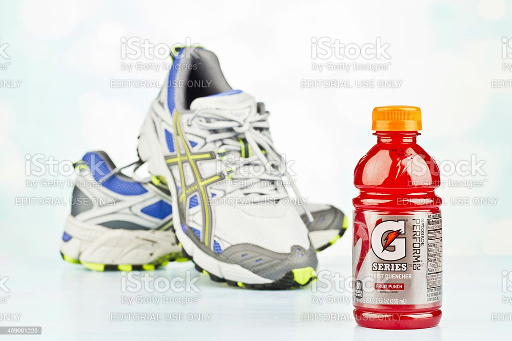 Women's Running Essentials: Sports Shoes and Gatorade stock photo