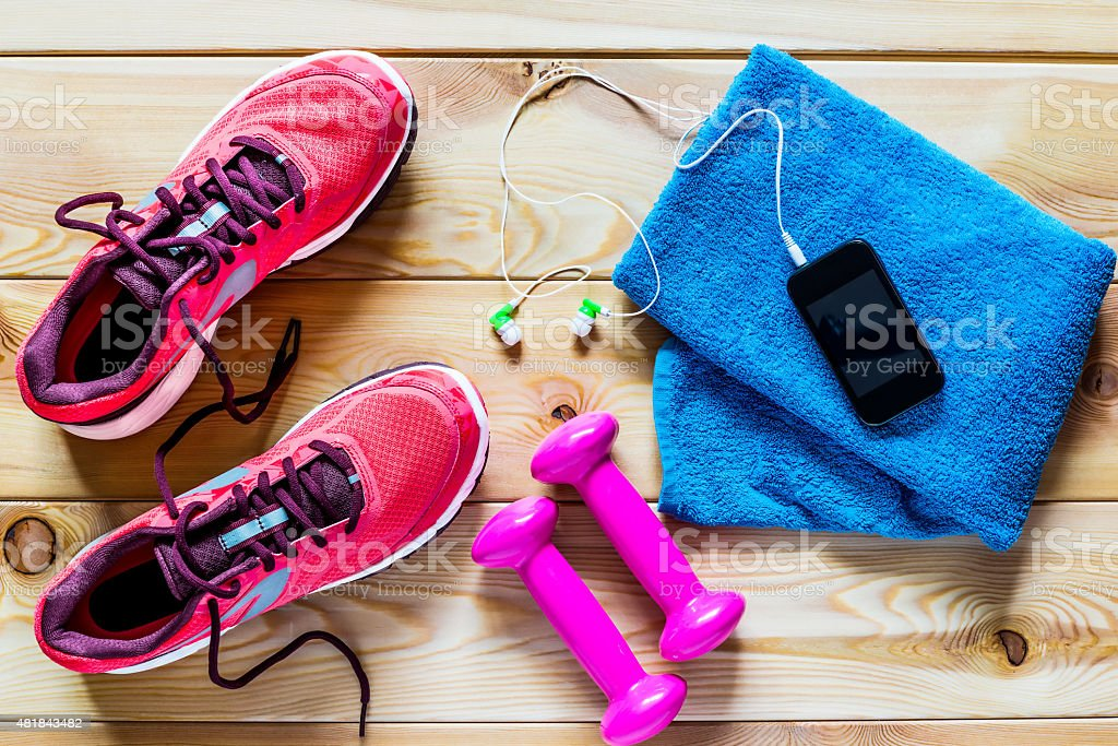 Women's running shoes and dumbbells for training stock photo