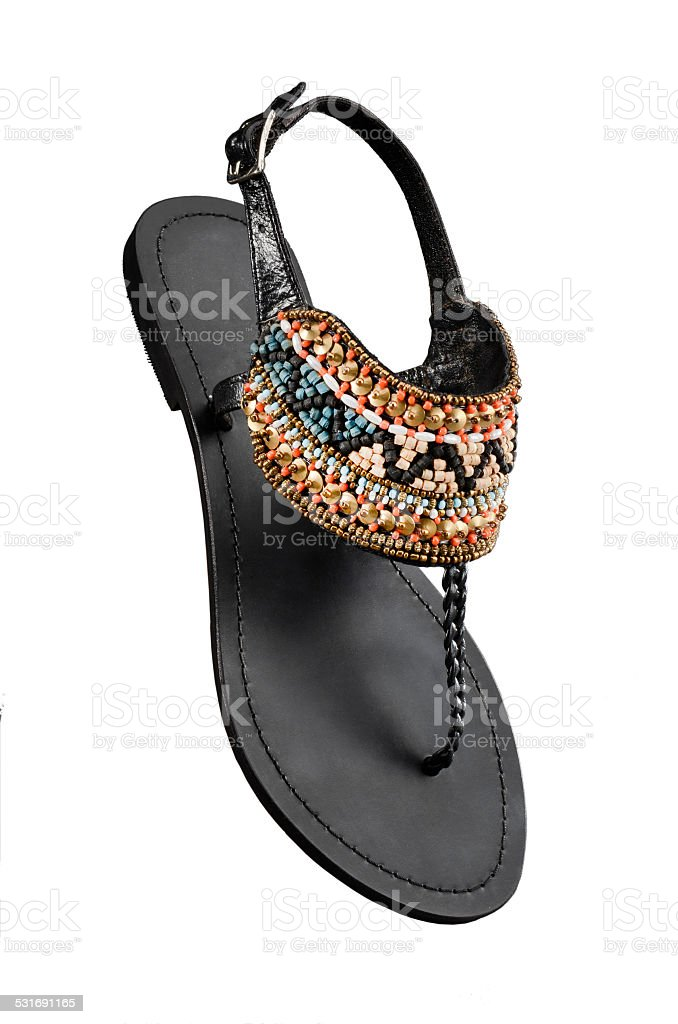 Women's Sandal shoe with beads design in front stock photo