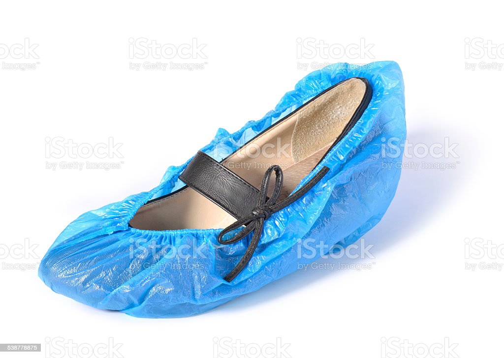 Women's shoe in shoe covers. stock photo