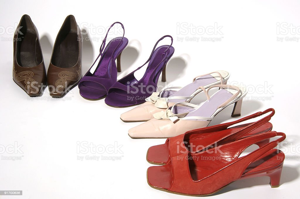 Womens shoes in a row on white background stock photo