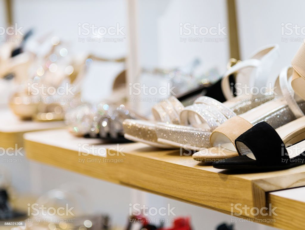 Women's shoes on sale displayed in a store stock photo