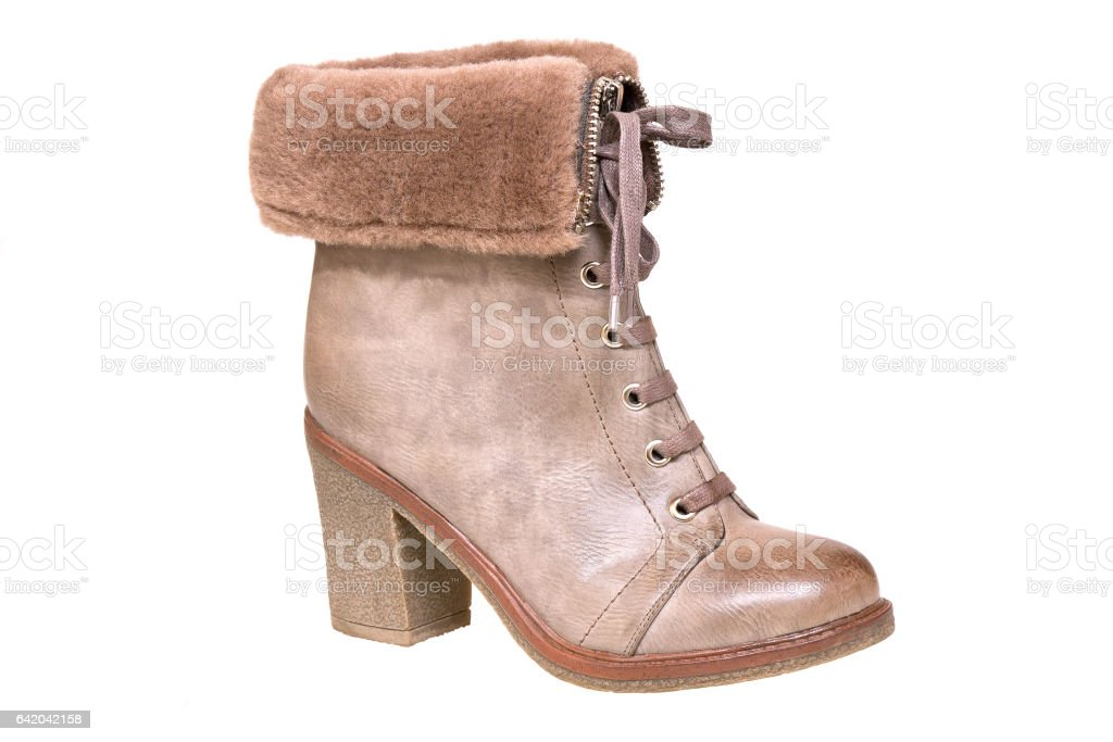 Women's shoes. One brown winter boot on white background stock photo