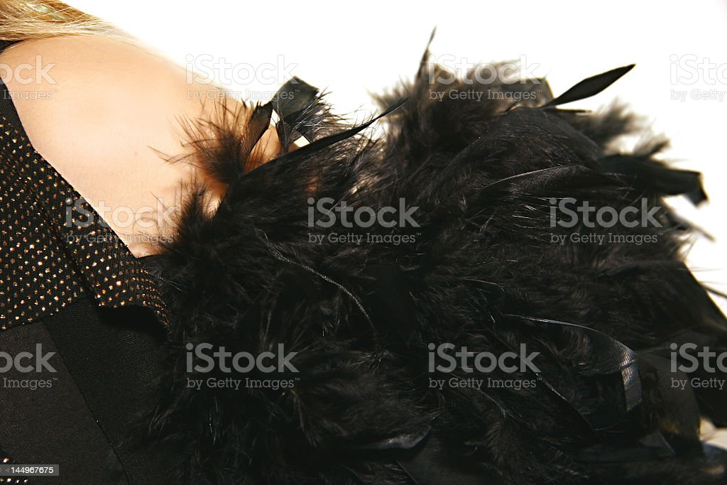 women's shoulder with black feather boa royalty-free stock photo