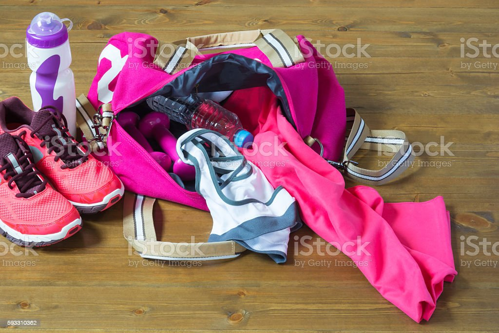 Women's sports bag with stuff inside stock photo