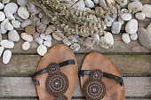 Womens summer shoes on a wooden surface. Background.