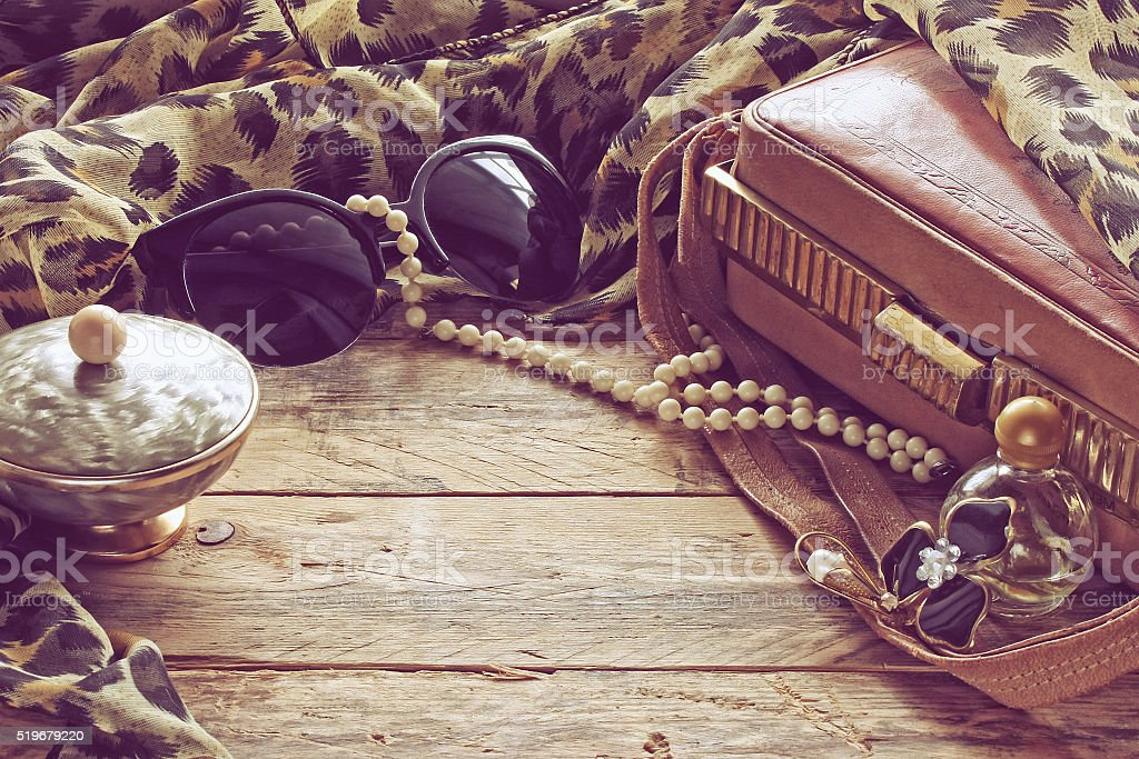 womens vintage accessories, powder box, scarf, necklace, sunglas stock photo