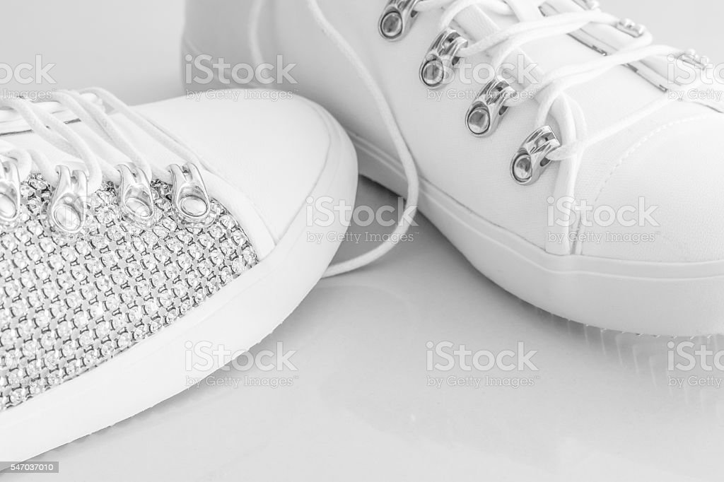 Women's white studded shoes stock photo