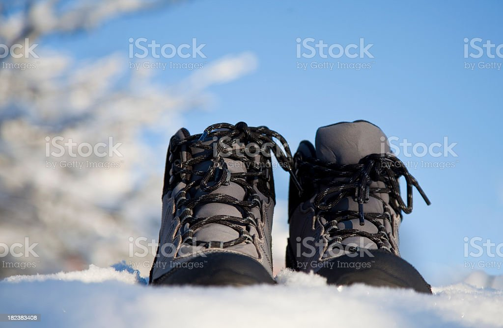 Women's winter hiking boots on snow stock photo