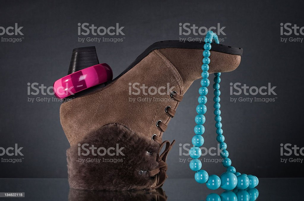 Women's winter shoes and jewelry. royalty-free stock photo