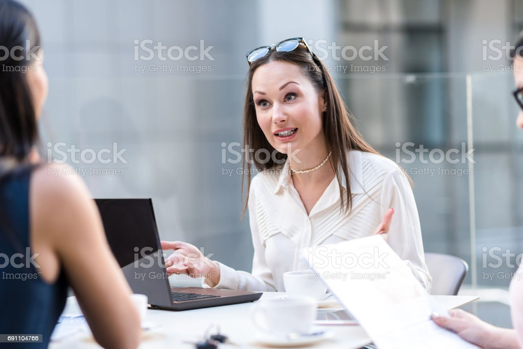 Are you sure. Female expressing surprise while speaking with coworker...