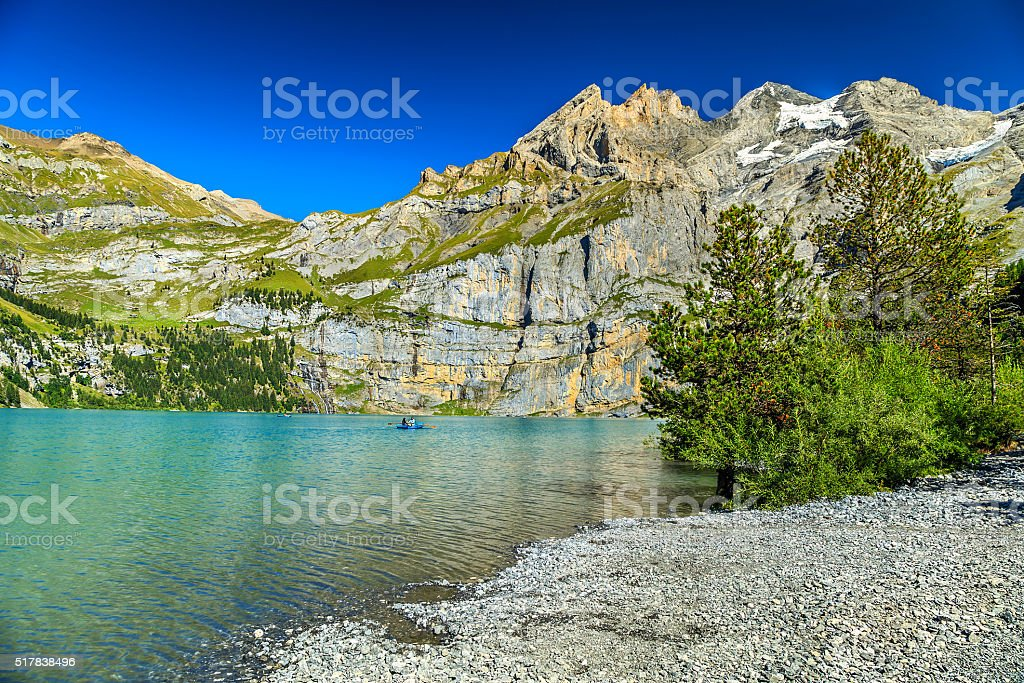 Wonderful blue lake with high mountains and glaciers,Oeschinensee,Switzerland stock photo