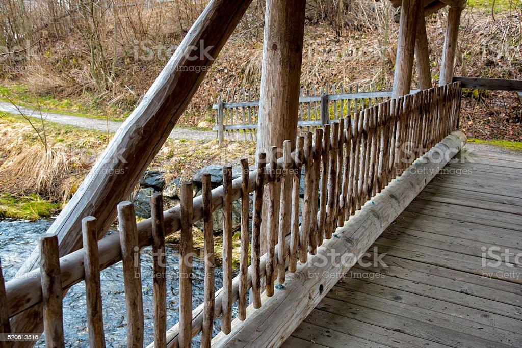 Wonderful bridge over water stream in Germany stock photo