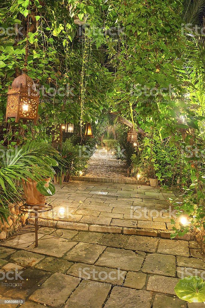 Wonderful garden path at night, illuminated by candles, and lanterns. stock photo