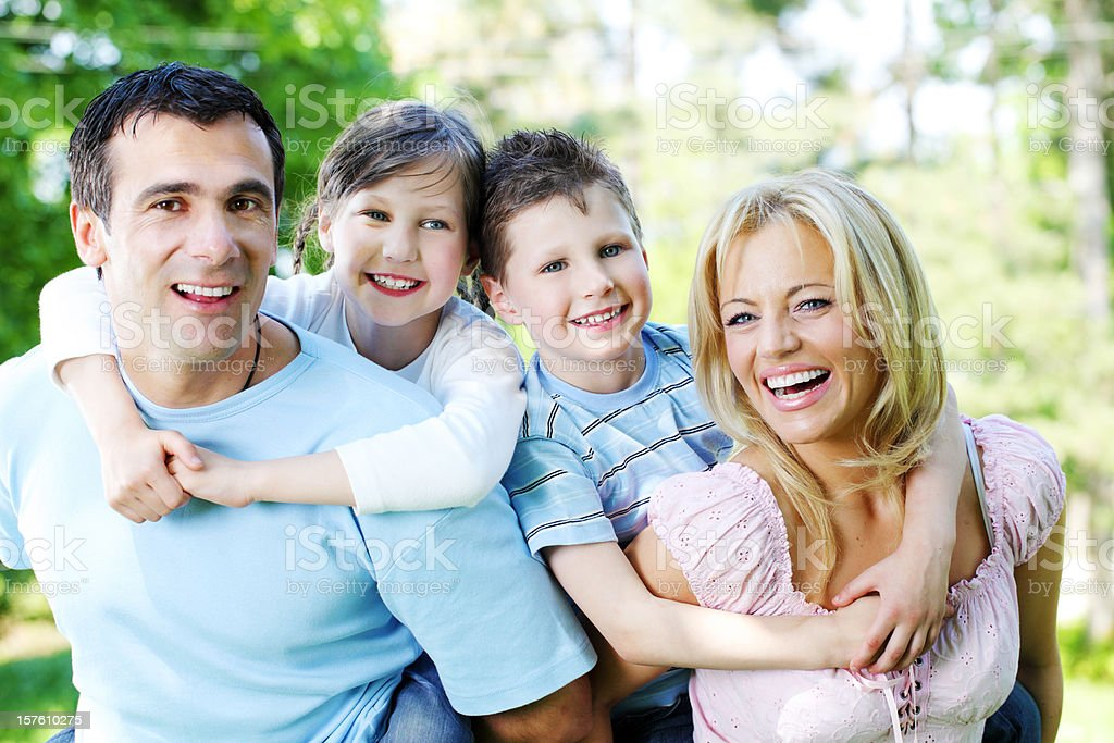 Wonderful happy family spent the day in park. royalty-free stock photo
